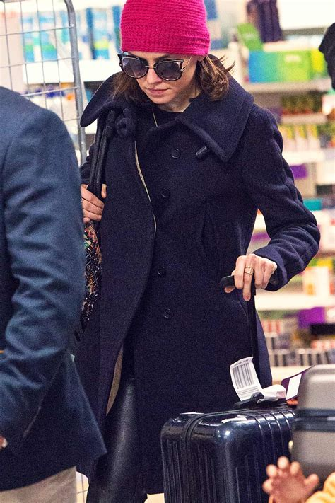 Daisy Ridley at Heathrow Airport - Leather Celebrities