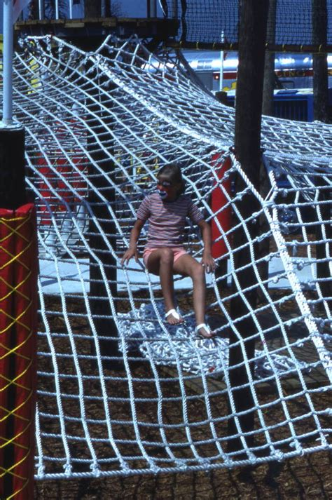 Florida Memory - Child climbing on rope net at the Circus